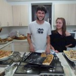 Balazs and Norah making special pizza for Kahlil's birthday.