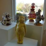Bed of Roses and Yellow Doll with Marcia's soft toys. Yellow Doll has a fright-wig. She is one of the press moulds.