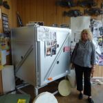 Mary checking out a gas kiln in Seattle. we are considering sharing a kiln.