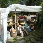 The contents of my whole studio under wraps in the back yard.  Truck loads went to the city dump.
